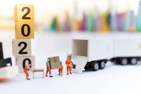 Miniature people : Worker move thing to destination place. Image use for logistic concept, shipment order from customer