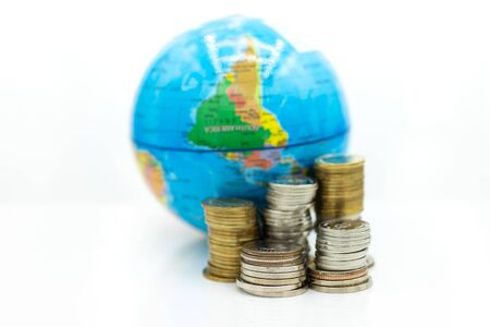 Stack of coin beside the world map. Image use for investment, business international concept. Stock Photo