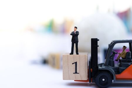 Miniature people : Businessmen stand on the wood block. The sequence of matches. Image use for as a sequence of business conception indicators. Stock Photo - 143229564