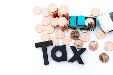 Wooden text is TAX. Image use for Tax calculation every year for everyone, Annual car tax, business concept