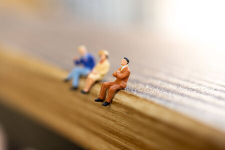 Miniature people : Group business sitting on the table. Image use for education, business concept. Stock Photo