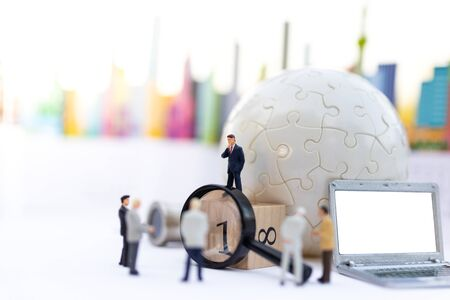 Miniature people, Group of businessmen work with team, using as background Choice of the best suited employee, HR, HRM, HRD, job recruiter concepts.