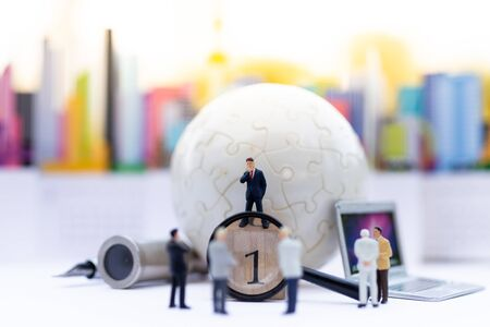 Miniature people, Group of businessmen work with team, using as background Choice of the best suited employee, HR, HRM, HRD, job recruiter concepts. Stock Photo