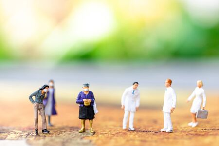 Miniature people: Check your health with doctor. Image use for drug, pills, capsules ,Health and medicine concept.