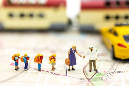 Miniature people : Family stand on the map with the car . Image use for Drive your progress, Accelerate the journey to the destination