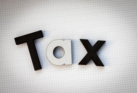 Wooden text is TAX. Image use for Tax calculation every year for everyone, business concept Stock Photo