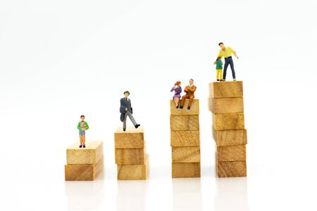 Miniature people: Enhance progress moment. Image use for opportunity for another step of success. In every important moment of yours