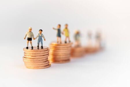 Miniature people: Children standing on top of stacked coins . Image use for background , Life insurance concept, Fund for education