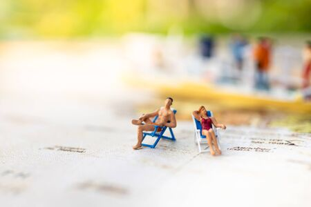 Miniature people : Young in swimsuit and friend. Image use for holiday, vacation concept.