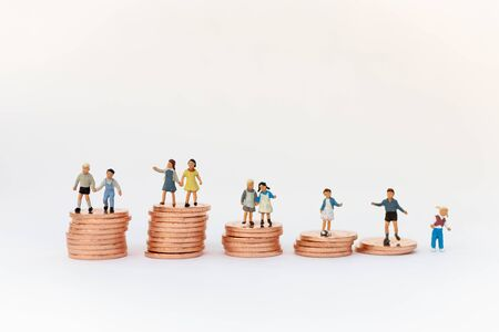 Miniature people: Children standing on top of stacked coins . Image use for background , Life insurance concept, Fund for education Stock Photo - 144199114