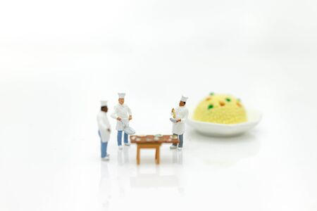 Miniature people: Chefs choose best raw materials for cooking for consumers. Image use for food and beverage concept, business concept. Stock Photo