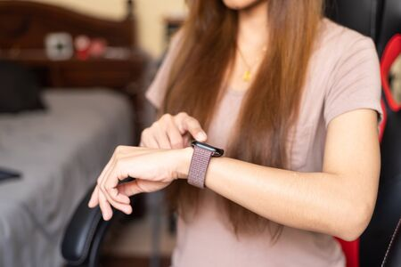 Women wear smartwatch. Watching the time, image use for meeting, business, technology concept Stock Photo