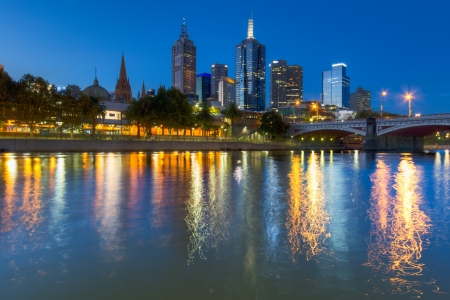 Lights of the Melbourne skyline at dusk reflected in the Yarra River  Stock Photo