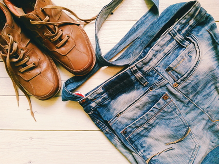 mens: Brown leather mens shoes and denim bag Stock Photo