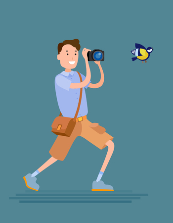 Flat style vector photographer male character tries to shoot a bird Illustration
