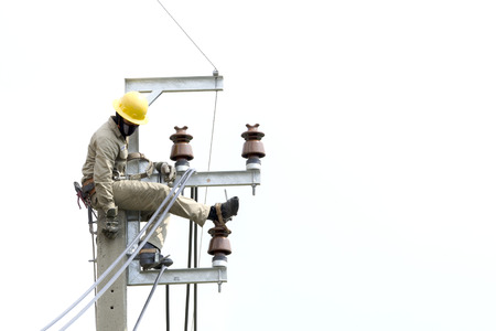 breakage: Electrician lineman at climbing work on electrical power pole. Stock Photo