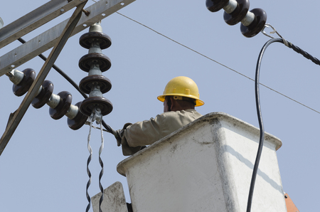 climbing cable: Close-up view of one electrician is repairing electric power system on hydraulic platform.