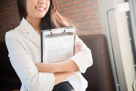 Women are embracing the job paperwork Stock Photo