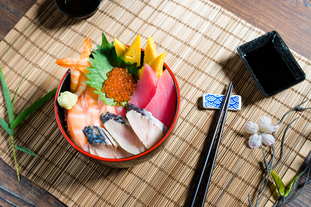 Sashimi is thinly sliced, raw food. It is one of the most famous dishes in the Japanese cuisine.