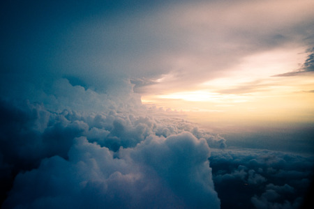 While flying through a cloud of rain. And meet the light of day. Stock Photo