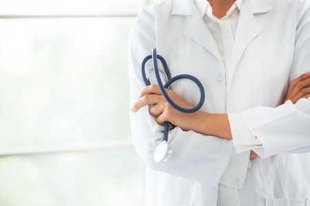 The doctor standing and holding stethoscope, Healthy lifestyle concept