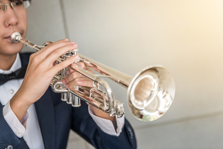 Trumpet instrument and Musician playing a trumpet in studio