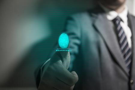 Businessman scan fingerprint biometric identity. concept of fingerprint security with advanced technological. Stock Photo