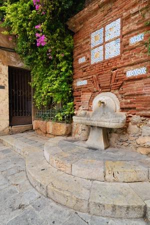Antique column on the street drinking Tarragona, Spain photo