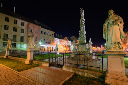 plague: KOSICE, SLOVAKIA - April 11, 2015: Main street in city center with Plague Column in the night in Kosice, Slovakia, April 11, 2015.