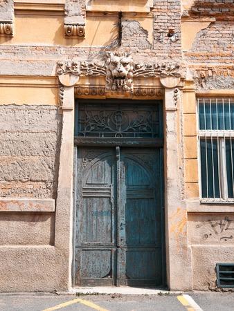 wood molding: A weathered turquoise door on the Presov, Slovakia, Europe Stock Photo