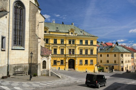 old town guildhall: Banska Stiavnica, Slovakia - April 14: Banska Stiavnica - town-hall and st. Katharine church on April 14, 2015 in Banska Stiavnica, Slovakia.  Mining town Banska Stiavnica is one of the most interesting towns in Slovakia and it is inscribed in UNESCO list Editorial
