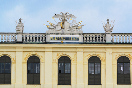 pompous: VIENNA, AUSTRIA - April 17: Detail from the facade of Schonbrunn Palace on April 17, 2015 in Vienna, Austria. The palace and gardens illustrate the tastes, interests, and aspirations of successive Habsburg monarchs. Editorial