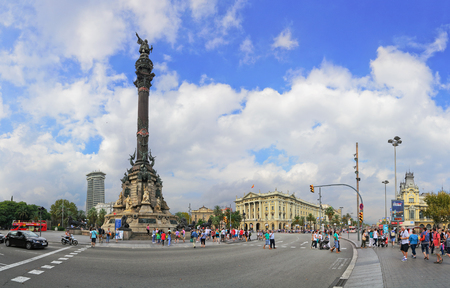 columb: BARCELONA, SPAIN - September 24, 2014: Traffic near Columbus monument on September 24, 2014 in Barcelona, Spain. Columbus Monument is 60 m. It is located at finish La Rambla and built in 1888