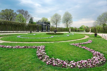schonbrunn palace: VIENNA, AUSTRIA - April 17, 2015: Schonbrunn Palace floral garden on April 17, 2015 in Vienna, Austria.