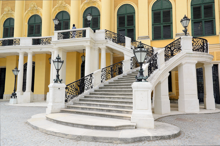 entranceway: Vienna, Austria - April 17, 2015: Schonbrunn Palace in Vienna on April 17, 2015. Schonbrunn Palace is a former imperial summer residence of Habsburg family.