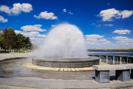 Beautiful Fountain on a background of clouds, Dnepropetrovsk, Ukraine.