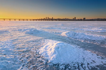 dnepr: Beautiful winter landscape with frozen river and sunset sky. Composition of nature. Ukraine, Dnepropetrovsk