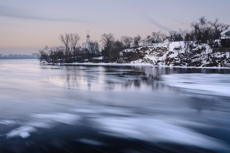 Aerial view of the great river with floating ice floes during the dusk. Drifting of ice. Driving of ice. Ice floe. motion blur. Monastyrsky Island, Dnepropetrovsk, Ukraine, Europe Stock Photo