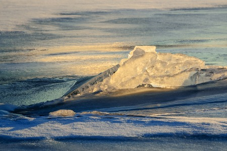ice floe: A beautiful epic ice crystal on the snow in the rays of the setting sun. Stock Photo