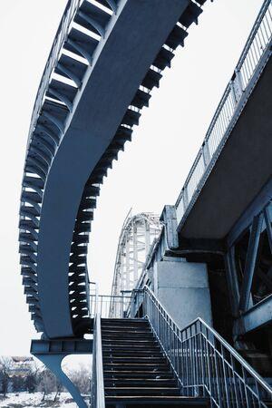 Deserted pedestrian bridge at day in the city of Dnepropetrovsk, Ukraine Stock Photo