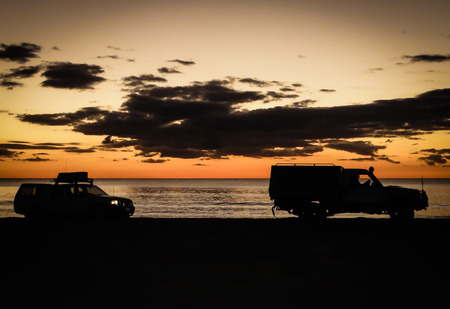 4wd: 4WD silhouette Cable Beach Broome Stock Photo