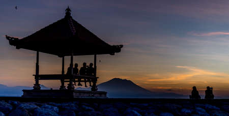 sanur: People relaxing watching a sunrise in Sanur Bali