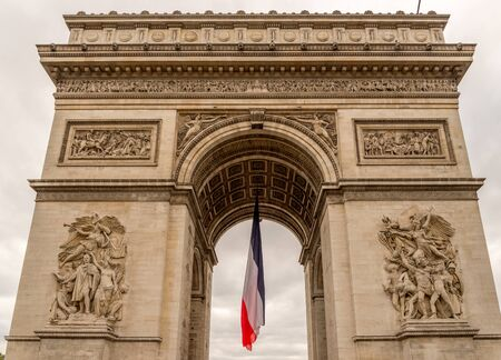 limp: Arc de Triomphe with french flag hanging limp below