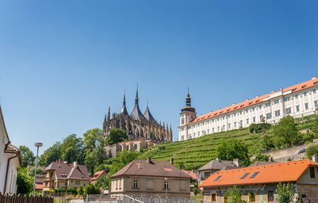 barbara: Saint Barbara Cathedral and Jesuit college with a small vineyard on the hill.