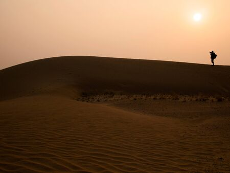 thar: Silhouette photographer at Thar Desert in sunset time Jaisalmer Rajasthan State India