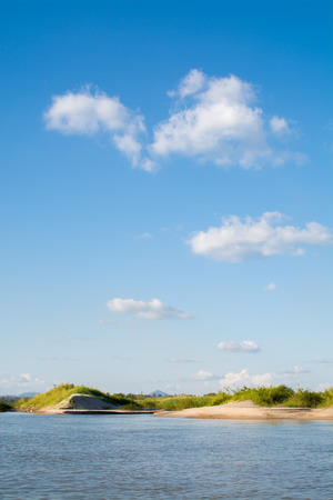 sandbank: sand beach of Mae Khong River at border of Laos and Thailand in blue sky and clouds background