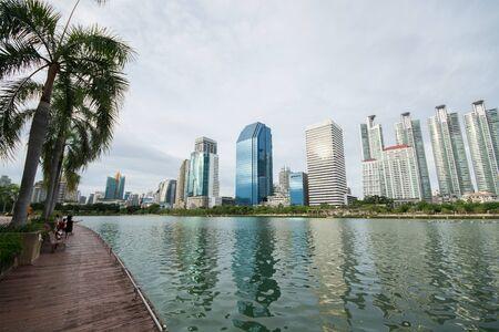 benjakitti: Bangkok, Thailand - July 5, 2015: Group of modern buildings near the lake at Benjakitti Park were under the rain clouds in Bangkok, Thailand