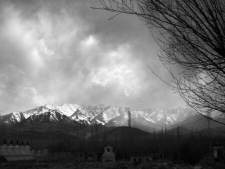 monotone: Monotone image of snow falling on the top of mountains in Ladakh, India