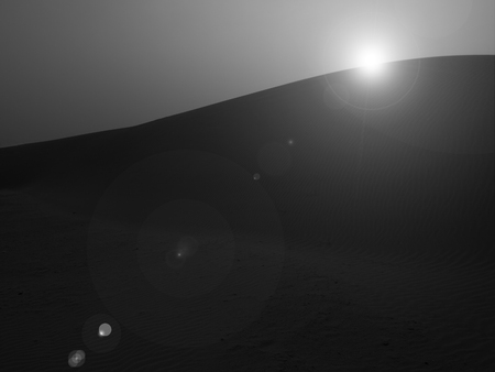 monotone: Monotone image of sunset at sand dune in Thar Desert with lens flare, Rajasthan, India
