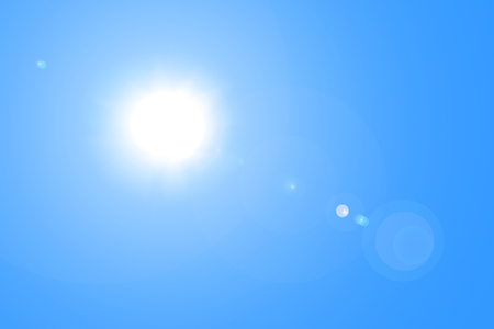 photographic effects: The sun and lens flare in blue sky